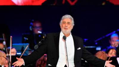 In this file photo taken on August 28, 2019 Spanish tenor Placido Domingo performs during his concert in the newly inaugurated sports and culture centre 'St Gellert Forum' in Szeged, southern Hungary. / AFP / Attila KISBENEDEK