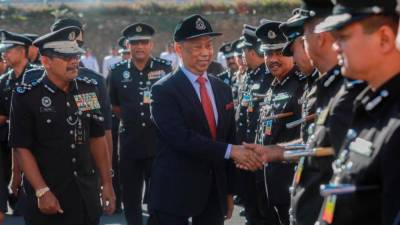 Home Minister Tan Sri Muhyiddin Yassin is greeted by officers from the General Operations Forces (PGA), on Feb 12, 2019. — Sunpix by Amirul Syafiq Mohd Din