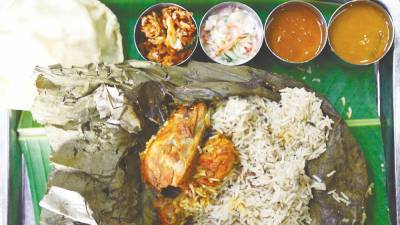 Sahana Banana Leaf ... Chicken lotus leaf biryani. –Zulkifli Ersal/theSun