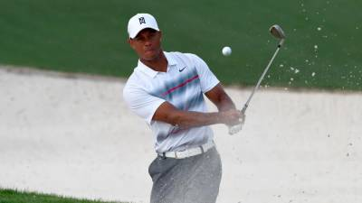 In this file photo taken on April 9, 2015, Tiger Woods hits out of the sand on the 10th hole during Round 1 of the 79th Masters Golf Tournament at Augusta National Golf Club in Augusta, Georgia. — AFP