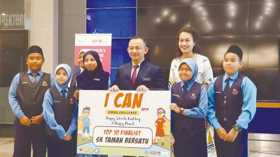THE BRIGHTEST ... Out of 94 participating teams, 10 teams emerged as winners of the ICAN School Challenge 2019. The students, aged between six to 16 years old, and their teams will represent Malaysia for this year's global ICAN Children's Summit in Italy that is expected to host 2,000 children and 800 educators. Education Minister Dr Maszlee Malik is seen here with the students of SK Taman Bersatu.