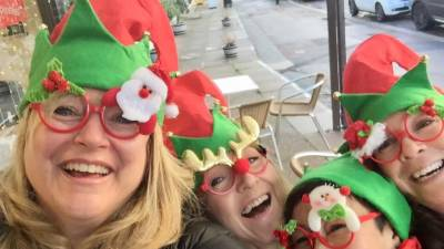 Melanie (second from right) and her band of hot-mama besties having a laugh in their 2017 Christmas accoutrements.