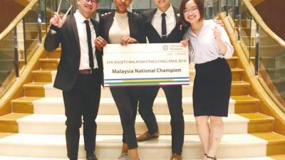 From left: Chin, Alaa Adil, Yap and Ong are all smiles after being announced as the Co-National Champions of the CFA Society Malaysia Ethics Challenge 2019.