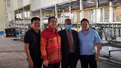 From left: Yoek Leong, Tan, Mohamad Fuzi and Xiong Sheng at the glove factory