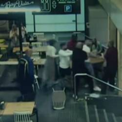 Onlookers rush to help the victim and pin down the attacker (right). — screengrab via 7 News Australia Youtube