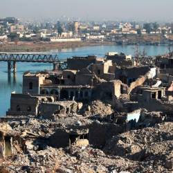 In this file photo taken on Jan 09, 2018 A picture shows the destruction of the old city of Mosul with the city's old bridge over the Tigris river in the background. — AFP