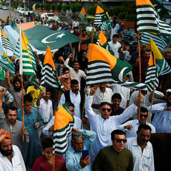 Pakistanis demonstrators carry flags of Pakistan-administered Kashmir during an anti-Indian protest in Karachi on August 18, 2019. — AFP