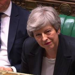 A video grab from footage broadcast by the UK Parliament's Parliamentary Recording Unit (PRU) shows Britain's Prime Minister Theresa May listening to a question during the weekly Prime Minister's Questions (PMQs) session in the House of Commons in London on May 22, 2019. - AFP