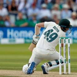 Australia's Steve Smith crumples to the ground after being hit in the neck by a Jofra Archer bouncer on Saturday. — AFP