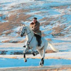 This undated picture released by Korean Central News Agency on October 16, 2019 shows North Korean leader Kim Jong Un riding a white horse amongst the first snow at Mouth Paektu. - AFP