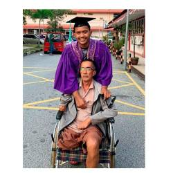 Muhammad Fahim Shamsuddin with his wheelchair-bound father Shamsuddin Md Amin, at the forensic unit of the Sultanah Nur Zahirah Hospital, on Nov 18, 2019. — Bernama