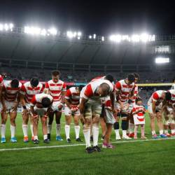 Japan's players bow to their fans after their match. — Reuters