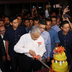 Prime Minister Tun Dr Mahathir cuts a birthday cake in celebration of his 94th birthday, at a PKR event in Port Dickson, on July 20, 2019.