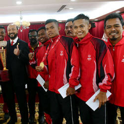 Mentri Besar Datuk Seri Mukhriz Tun Dr Mahathir (centre) posing for a picture together with the National Handicapped Football Squad, which emerged as champions in the Special Olympics International Football Championship recently.