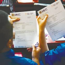 The two inmates, Jep, 36, and Ken, 34, showing off their offer letters to continue their postgraduate studies at Universiti Sains Malaysia (USM).