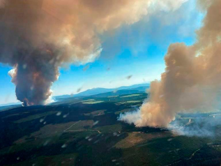 This handout photo courtesy of BC Wildfire Service shows two plumes of smoke from the Long Loch wildfire and the Derrickson Lake wildfire, British Columbia, on June 30, 2021. — AFP