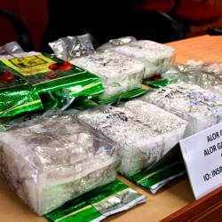 A total of eight packets of approximately 8.2 kg of syabu worth RM400,000 is displayed at a press conference. - Bernama