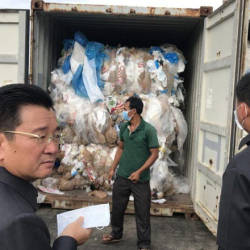 Kun Nhim, director-general of the General Department of Customs and Excise, and Environment Minister Say Samal inspect containers full of waste yesterday at the Sihanoukville Autonomous Port. - Khmer Times