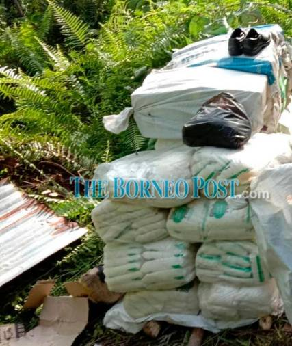 White sugar packs found left at Tapak Megah-Long Nawang, Kapit near the illegal entry point of the Sarawak-Kalimantan border on Saturday. — The Borneo Post