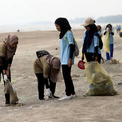 Volunteers pick up garbage at Pantai Sepat today. — Bernama