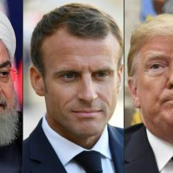 French President Emmanuel Macron (C) plans to meet separately at the UN General Assembly in New York with his Iranian and US counterparts, Hassan Rouhani (L) and Donald Trump. — AFP