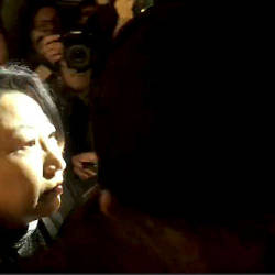 Hong Kong Justice Secretary Teresa Cheng walks as protesters surround her in London, yesterday, in this screengrab obtained via social media. — Reuters