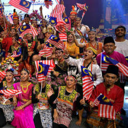 Participants of the Malaysia Day celebrations pose for a photo, at Stadium Perpaduan in Petra Jaya, on Sept 16, 2019.