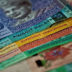 Ringgit closes lower against US dollar