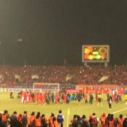 Vietnam players running to their fan to celebrate their victory against Malaysia.