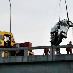 Rescue workers recover a SUV from the sea after it veered off the Penang Bridge on Jan 20, 2019. — Bernama