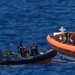 Migrants are rescued after throwing themselves in the sea off Italy's Lampedusa island in a desperate bid to swim ashore. — AFP