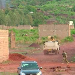 An armoured vehicle drives towards Le Campement Kangaba resort following an attack where gunmen stormed the resort in Dougourakoro, to the east of the capital Bamako, Mali. — AFP