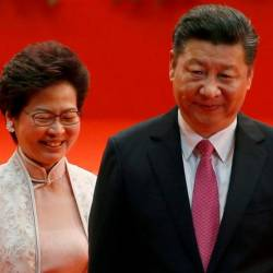 Filepix showing Hong Kong Chief Executive Carrie Lam (L) and Chinese President Xi Jinping walk after Lam took her oath, during the 20th anniversary of the city's handover from British to Chinese rule, in Hong Kong — Reuters