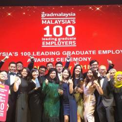 Nora (centre) with Maybank employees at the Graduates' Choice Award.