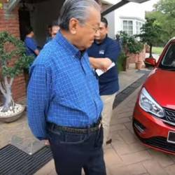 A screen grab of the video showing Tun Dr Mahathir Mohamad with the new Proton Saga. — Pix courtesy of Chedet Official Youtube channel
