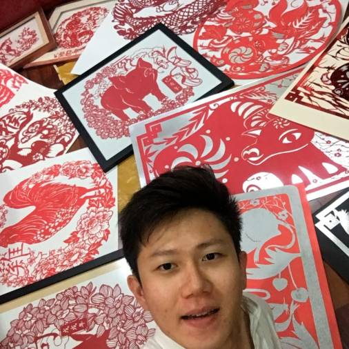 Chong with his Chinese Zodiac animal paper-cutting artworks. – COURTESY OF CHONG KAI ZEN