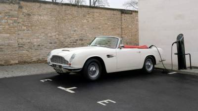 Aston Martin converted an original 1970 DB6 MkII Volante with its reversible EV powertrain concept.
