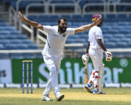 India court stays arrest warrant for cricket star Shami