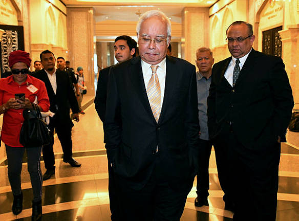 Najib gears up for graft trial with charm offensive