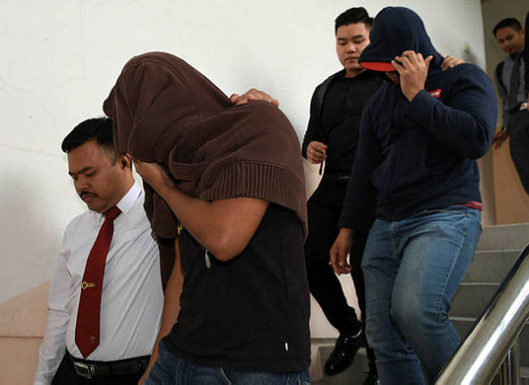 Two policemen plead not guilty to bribery