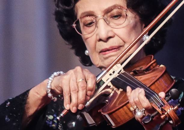 Prime Minister wife Tun Dr Siti Hasmah Mohd Ali playing the violin after the launch of Tun Dr Siti Hasmah Mohd Ali Scholarship for Creative Arts and Music during the National Women's Day Gala Dinner at Sunway Hotel and Resort tonight. AMIRUL SYAFIQ MOHD DIN / THESUN