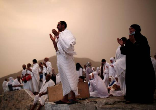 Muslim pilgrims pray on Mount Mercy on the plains of Arafat during the annual haj pilgrimage, outside the holy city of Mecca. REUTERS PIX