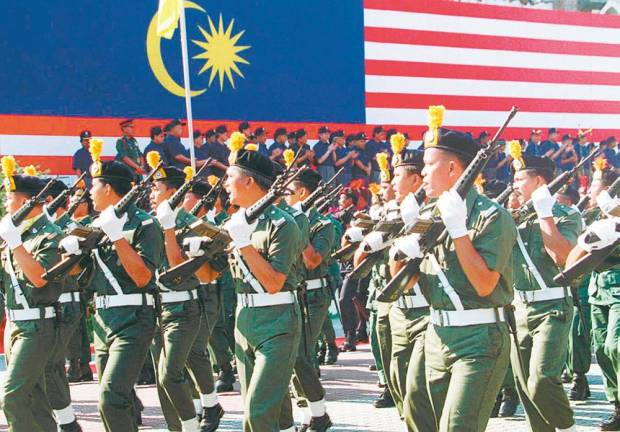 Members of the General Operations Force (GOF) marching pass the VIP stage during the 43rd National Day at Dataran Merdeka in the year 2000.