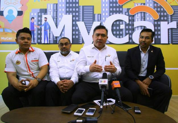 Get e-hailing services from other companies if the prices are high: Loke