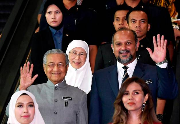 Deputy Prime Minister Datuk Seri Dr Wan Azizah Wan Ismail, Communication and Multimedia Minister Gobind Singh Deo and others accompany Prime Minister Tun Dr Mahathir Mohamad at the Putrajaya International Convention Centre in Kuala Lumpur on May 9.