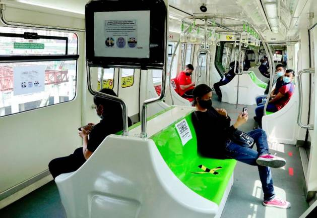 The monorail rider is still following the government-issued SOP on the first day of the Recovery Movement Control Order (RMCO). ZAHID IZZANI/THESUN