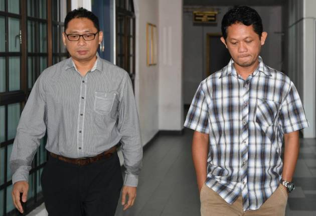 Two marine officers claim trial to bribery charges