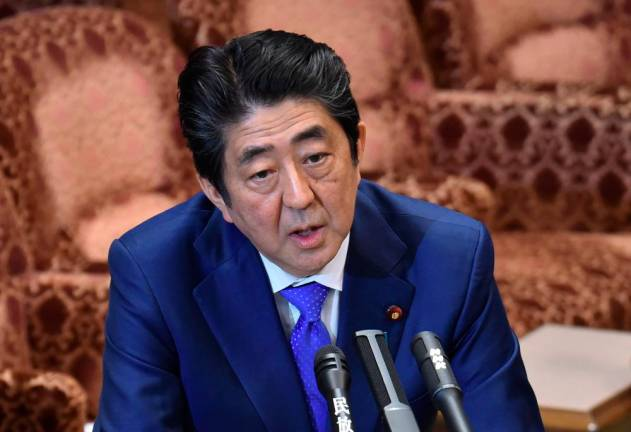 Japan's Abe instructs cabinet to compile economic package