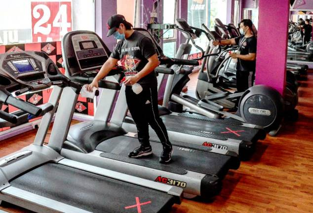 EZ Blast staff prepare to clean the gym area during reopen business at Sri Gombak, Kuala Lumpur. - ADIB RAWI YAHYA/THESUN