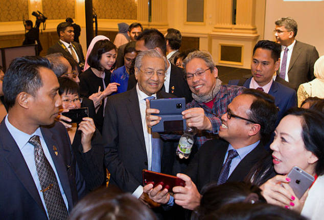 Prime Minister Tun Dr Mahathir Mohamad meets with Malaysians living in Austria and Slovakia during an event in Vienna on Monday, Jan 21, 2019. — Bernama